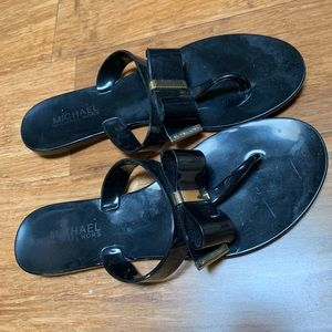 Michael Kors black jelly flip flops with bows